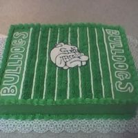 Football Cake Did this for a local kids football team, end of year party. Cake is two layers covered in buttercream, and bulldog in center is made out of...