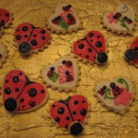 Lady Bugs Cream Cheese Cookies with cream cheese icing for a 1st b-day.
