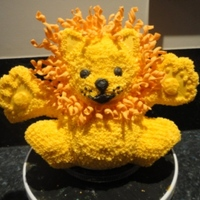 Cuddly Lion Lion from Wilton Yearbook 2011 (modified paws), vanilla pound cake with buttercream icing, cookie paws, fondant curls for mane (used the...
