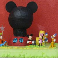 Mickey Mouse Clubhouse My daughter wanted a Mickey Mouse cake for her 3rd birthday. I used the wilton ball pan to create the clubhouse along with other pieces cut...