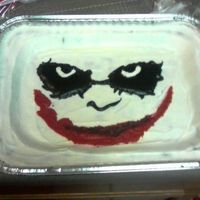 Joker Face Cookie Cake A cookie cake for the 16 year old across the street. He wanted just the joker's face. I think it actually turned out pretty well.