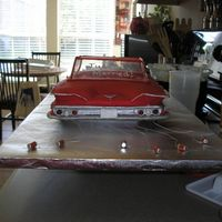 1960 Impala Back This is the back of the Impala cake. I used transparency sheets to make the top of the car. I got miniature soda cans and trailed them from...