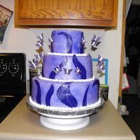 Purple Butterfly Wedding Cake I made this for a friend whose theme was butterflies and the color was purple. The cake was a little more purple than I intended, but they...