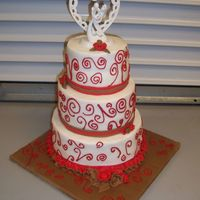 Chocolate Apple Wedding Cake Client wanted a wedding cake with red and brown with the topper.