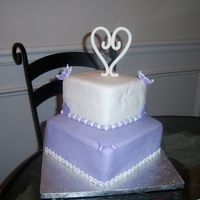 Two Tier Wedding Cake Bride had a very small wedding so she wanted a small cake. Her colors were lavendar and white.