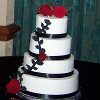 Son's Wedding Cake 6/810/12, Each tier had 3 different fillings of choc/white BC/red rasp. Iced in BC; fondant black leaves.Cake made from a photo supplied by...