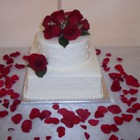 Sm_Wed.jpg 11 inch square and 8 inch round. Buttercream frosting and real roses. Made for one of my husbands co workers who ws having a small wedding...