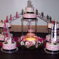 "Fountain Wedding First time using fountain and stairs. So glad this one is over. Middle tier is a 10"" and 6"" round. Side cakes are 10"" and 8&..."