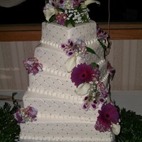 Kellys Cake 5 tiered cake, 14,12,10,8,6 All buttercream with real flowers. Quilting pattern with silver dragees. Had a great time making this cake,went...