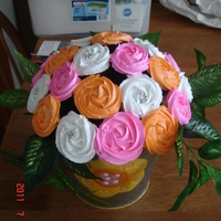 Cupcake Bouquet 24 mini cupcakes make up this fun bouquet. It's funny how people never want to take it apart and eat it! Roses were made using a...