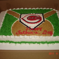 Batter Up!   Cincinnati Reds baseball cake made for a HUGE fan! His daughter's planned this all themselves!