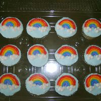Rainbow Cupcakes   Decorated in butter cream with tip 101 for the rainbows.