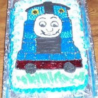 Thomas  This is my second cake, I made it for my sons girlfriends little boy who loves Thomas. I am disappointed with the face. Somewhere between...