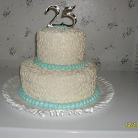 Happy 25Th Anniversary! This was the cake that I made for my Dad and Step-Mom for their 25th Anniversary. I also helped make their original Wedding cake...when I...