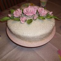 My Mother's 65Th Birthday  This is one of my very first cakes. Sorry about the flowers, I was in such a hurry and I didn't have much time to arrange the flowers...