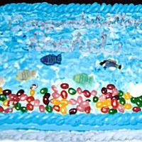 Lots Of Fishies Cake! This underwater view was created with buttercream, jelly beans and rice paper images. A lot of fun!