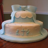 "Baby Shower   10"" & 6"" rounds. Yellow cake covered in lemon icing with fondant decorations. Thanks for looking!"
