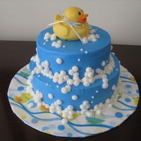Rubber Ducky Yellow cake covered with lemon icing. Fondant ducky.