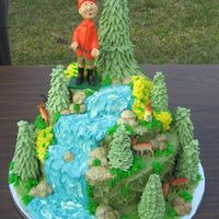 Hunter This was a groom's cake made for a Outdoor's Man! The cake is covered in buttercream and the trees are made of royal icing.