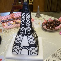 Eiffel Tower Eiffel Tower cake, made for nephew's birthday, bottom 4 layers stacked white and strawberry cake, top is rkt covered all buttercream....