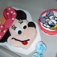 122314238140515.jpg Minnie and Daisy smash cake all buttercream.