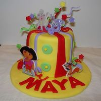 Dora Birthday Cake  This is taken by an idea by Sugarshack. It was for a friends little girl's first birthday party. It is a dora theme. Fondant covered....