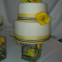"Round Wedding Cake With Yellow Callas For my SIL's wedding cake. This is a cheesecake covered with fondant. It is a 6"" and 8"" cake. The cheesecakes were 3 inches..."