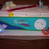 Pampers (Boy) 2 9x13 cakes stacked icing with BC edible image photos. Diapers are banana twins wrapped in fondant. Other decorations are plastic that I...