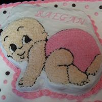 Special Delivery Baby Girl W/ Pink & Brown Dots Crawling This is a cake done using the Wilton Special Delivery Baby cake pan and a sheet cake pan. I put brown and pink polka dots on the sheet cake...