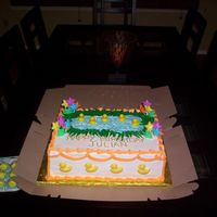 Party At The Duck Pond My son Julian's first birthday cake. The cake is a half sheet double stacked, yellow cake iced with whipped cream and filled with...