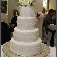 Lindsay's Wedding Cake This cake was made for one of my favorite brides. It was a white cake and red velvet cake (a layer of each) filled with my own version a...