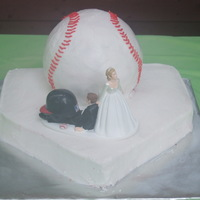 Homerun This is a groom's cake. The groom loves baseball. The home plate is carved and covered with buttercreme. The baseball was done with...