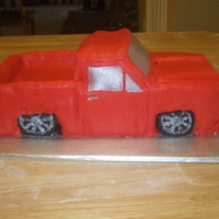"Chevy Pickup This is a truck make with cake and RKT. It is covered in Fondant, the window are ""painted"" silver."