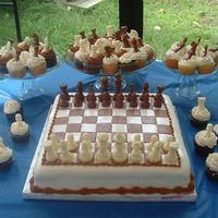 Dylans 9Th Birthday Did this for my son. He loves chess. WASC with strawberry filling. Chocolate and vanilla cupcakes.