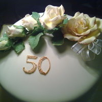 50Th Birthday Choclate cake with yellow sugar paste roses