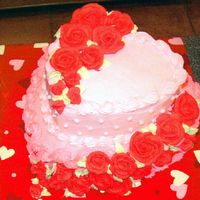Hearts And Roses Heart shape pan. Royal Icing Roses. Buttercream base.