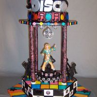 Disco Cake I made this cake for my niece's 9th birthday. She had a disco themed party so I decide to make this disco cake. She's dancing on...