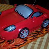 Cruise_41640.jpg This cake I made for my son's 14th birthday. The wheels and tail are made out of styrofoam. I used clear plastic for the front lights...