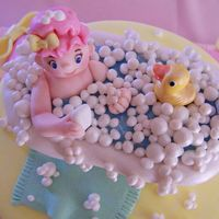Baby In Bathtub Cake Topper Figure is made out of fondant.