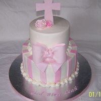 Baptism Cake 6 & 9 inch rounds, fondant/gumpaste bow and cross, everything is edible.
