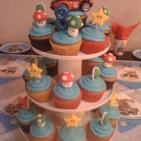 Mario Kart Cupcake Tower   Mario Kart Cupcake toppers were made with fondant.