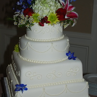 "4 Tier Wedding Cake  This is a 14"", 12"" square and a 10"" and 7"" round, all white cake, iced with BC and coveredwith MMF. The piping and..."