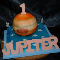 Jupiter's First Birthday! This is for a little boy named Jupiter, it is his first birthday. I used the ball pan for the planet, it is strawberry, the bottom cake is...