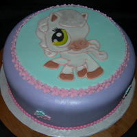 Littlest Pet Shop This was the first time I tried this techinique. The lady that ordered it seen it on cakejournals flickr site. I learned a lot and it will...