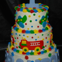 Fire Trucks And Airplanes I enjoyed making this cake. My first time to cut fire trucks and airplanes and assemble them for a cake. The top and bottom tier are white...