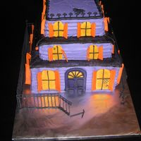 Haunted House I got the inspiration for this cake from another CCuser and tried my best to make it! It was REALLY heavy and the royal icing gate broke,...