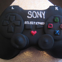 Playstation 3 Controller this cake was done for a couples 1st anniversary. He likes playstation 3.
