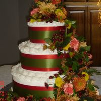 Fall Wedding Cake This was for a wonderful friend of mine. The cake is french vanilla with bc icing. the flowers are real with burnt orange and green ribbon...