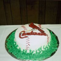 Cardinals Baseball This is a strawberry cake with BC icing. Cardinal is royal icing. This is the first time i have use royal icing. This was my cousins grooms...
