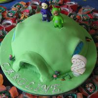 Teletubbies All fondant, except the teletubbies themselves - I am really not good in working with modeling past. Shame I could not get to to stand up...